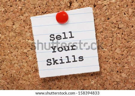 The phrase Sell Your Skills  typed onto a scrap of lined paper and pinned to a cork notice board. The ability to demonstrate out talents is essential for career success and your job search. - stock photo