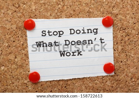 The phrase Stop Doing What Doesn't Work on a paper note pinned to a cork notice board. In both business and our own lives we have to look for efficiency and best practice to move forward. - stock photo