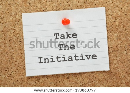 The phrase Take The Initiative typed on a piece of lined paper and pinned to a cork notice board - stock photo