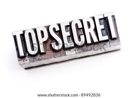 "The phrase ""Top Secret"" in letterpress type. Cross processed & narrow focus. - stock photo"