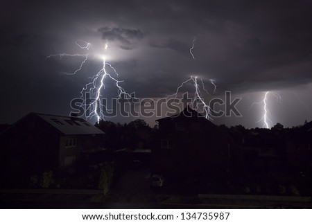 The picture shows a thunderstorm at night. - stock photo