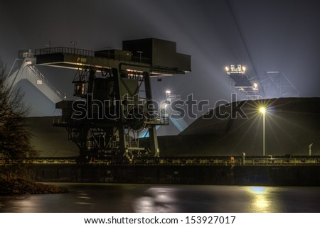 The picture shows the coal dump of a coal power plant. - stock photo