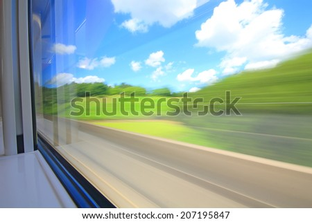 The picture shows the speed of the train, looking out the window of the train. - stock photo