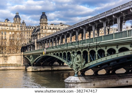 The picturesque embankments of the Seine in Paris. Buildings, trees, bridge, ships and river. France. - stock photo