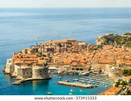 The picturesque landscape of the old town of Dubrovnik (Croatia) and the Adriatic sea with many boats, from above. Dubrovnik is part of the UNESCO World Heritage Site. - stock photo