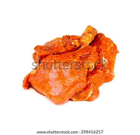 The pieces of meat in the marinade on a white background - stock photo