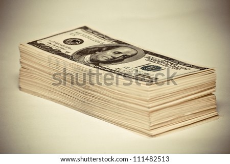 The pile of US federal reserve notes $100. Old style photo. - stock photo