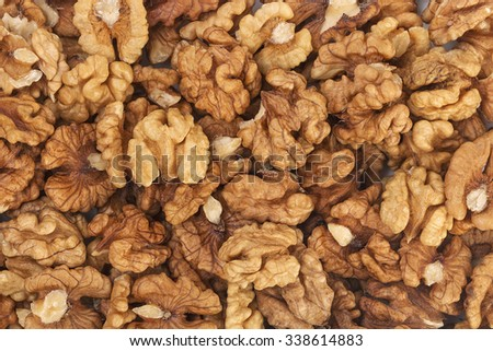The pile of walnuts kernels. Close up. - stock photo