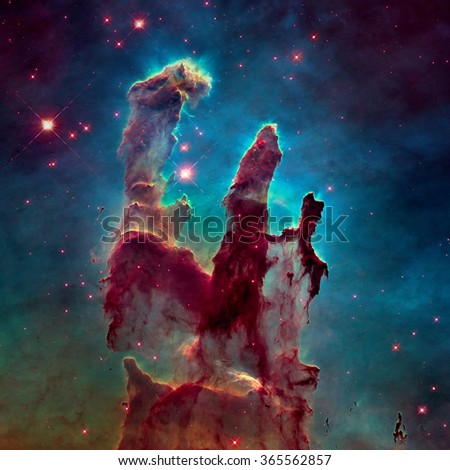 The Pillars of Creation. The Eagle Nebula (M16, NGC 6611) is a young open cluster of stars in the constellation Serpens. Retouched colored image. Elements of this image furnished by NASA. - stock photo