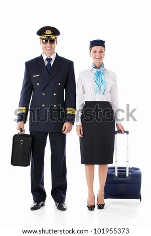 The pilot and flight attendant with a suitcase on a white background - stock photo