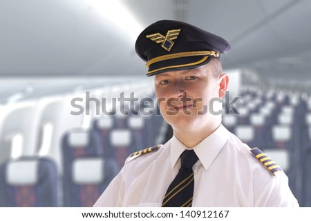 The pilot in the cabin waiting for passengers - stock photo