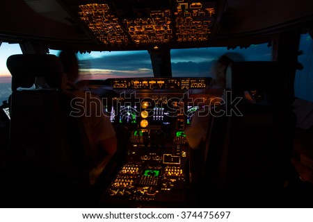 The pilots in the cockpit are greeted sunrise - stock photo