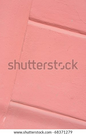 The pink colored walls with texture - stock photo
