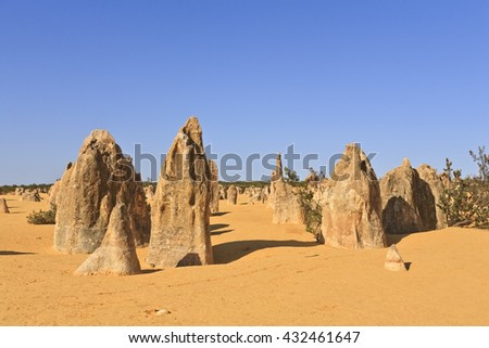 The Pinnacles, an area of eroded limestone formations in Nambung National Park, north of Perth in Western Australia. - stock photo