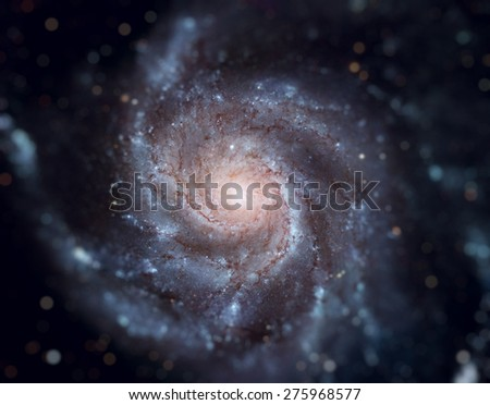The Pinwheel Galaxy (also known as Messier 101, M101 or NGC 5457) is a face-on spiral galaxy in the constellation Ursa Major. Retouched image with small DOF. Elements of this image furnished by NASA. - stock photo