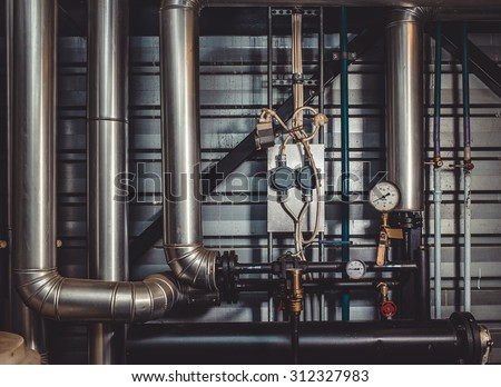 the pipes in the boiler room - stock photo