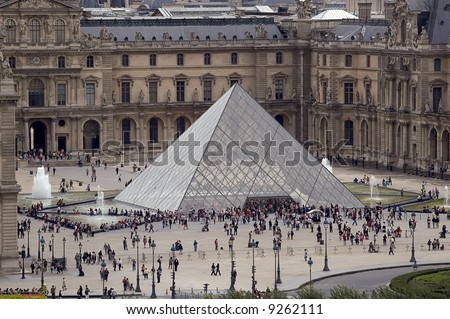 The piramid of museum Louvre - stock photo