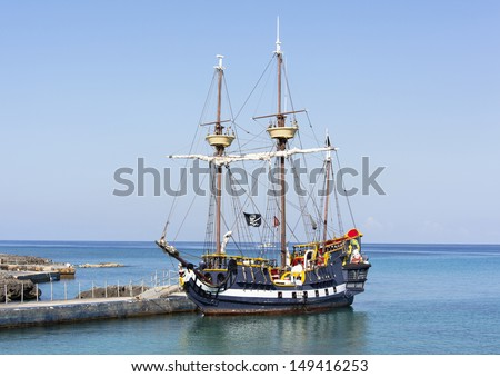 The pirate ship docked near Grand Cayman island, the popular tourist attraction in Caribbean (Cayman Islands). - stock photo
