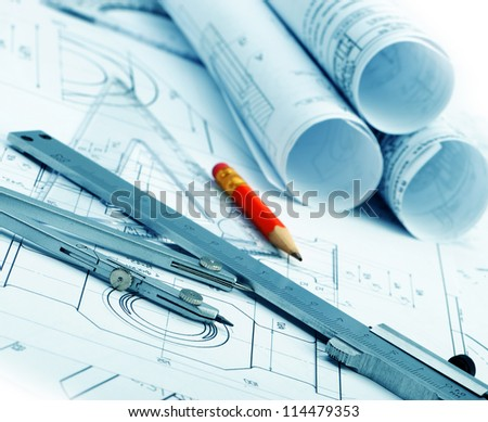 The plan industrial details, a protractor, caliper, divider and a red pencil. A photo closeup. Blue toning - stock photo
