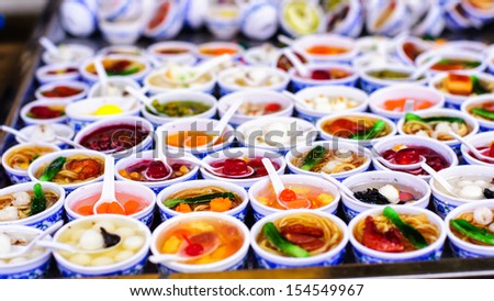 The plastic samples of Vietnamese sweet soup that have been sold in Hoi An city, Vietnam - stock photo