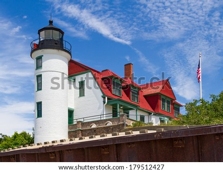 The Point Betsie Lighthouse, completed in 1858, is located on Lake Michigan north of Frankfurt, Michigan and marks the south entrance to the Manitou Passage. - stock photo