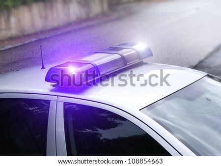 The police beacon on the car - stock photo