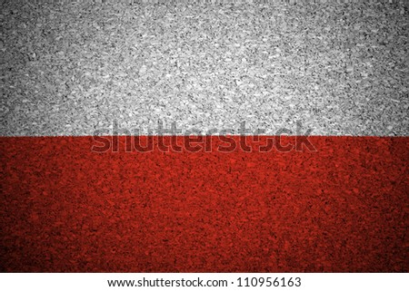 The Polish flag painted on a cork board. - stock photo