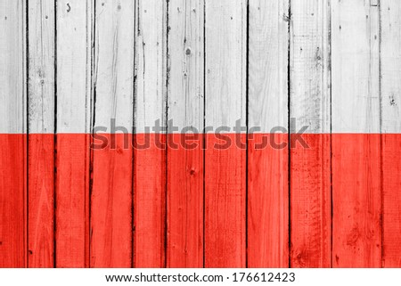 The Polish flag painted on a wooden fence - stock photo