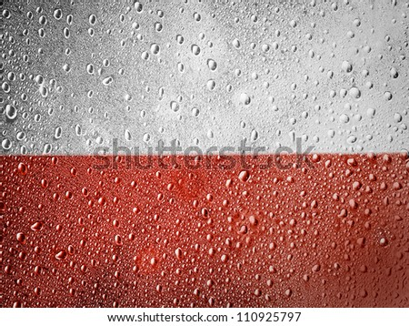 The Polish flag painted on metal surface covered with rain drops - stock photo