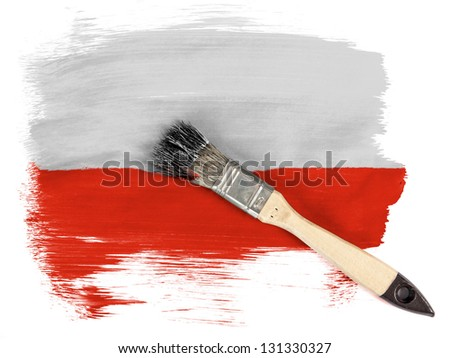 The Polish flag painted with brush over it - stock photo