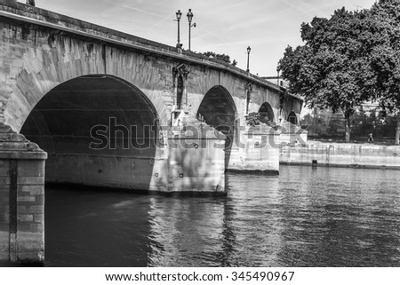 The Pont Marie passes over the Seine River connecting the Right Bank to Ile. Saint Louis in Paris France. - stock photo