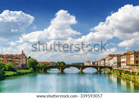 The Ponte alla Carraia over the Arno River in Florence, Tuscany, Italy. View from the Ponte Santa Trinita (Holy Trinity Bridge). Florence is a popular tourist destination of Europe. - stock photo