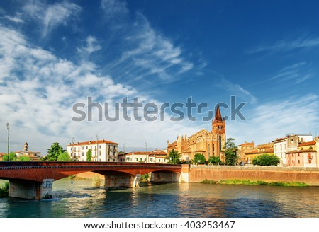 The Ponte Navi and view of the Saints Fermo and Rustico church from the Adige River in Verona, Italy. Verona is a popular tourist destination of Europe. - stock photo