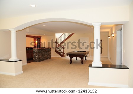 The Pool Room - A pool table sits in the game room of a luxury home. - stock photo