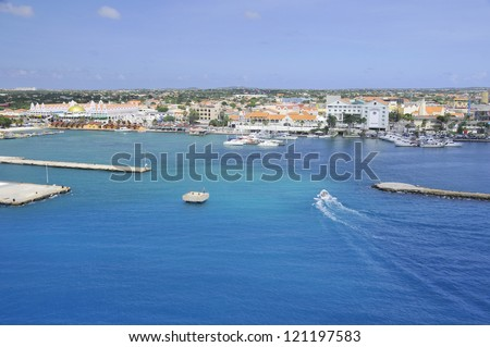 The port of Oranjestad, the currently main commercial harbor of Aruba, is situated on the south-western end of the island. - stock photo