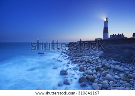 The Portland Bill Lighthouse on the Isle of Portland in Dorset, England at night. - stock photo