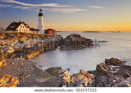 The Portland Head Lighthouse in Cape Elizabeth, Maine, USA. Photographed at sunrise. - stock photo