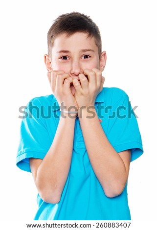 The portrait of a boy with emotions expressive, with charisma on a white background with a blue shirt pointing finger showing okay or Like - stock photo