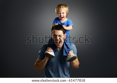 The portrait of a little boy and his father - stock photo