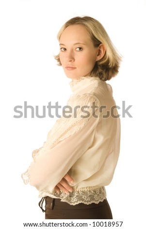 The portrait of a woman looking back over her shoulder - stock photo