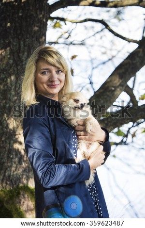 The portrait of woman and her dog - stock photo