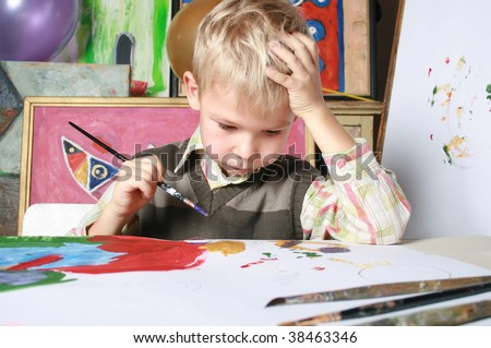 The portrait, the boy drawing by paints - stock photo