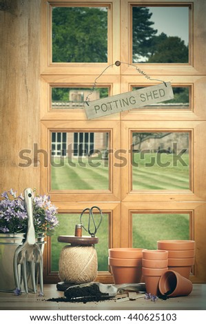 The potting shed with window overlooking garden - stock photo