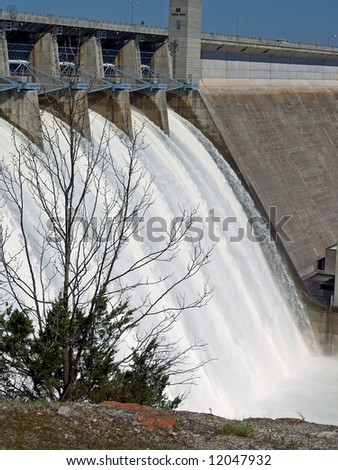 The power of water escaping through flood gates - stock photo
