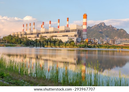 The power plant is producing electricity for a public use. - stock photo