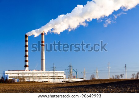 The power station located about chemical plant (winter season) - stock photo