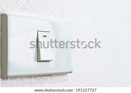 The power switch is pressed in turn on - stock photo