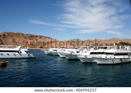 The powerboat in the Red Sea against small mountains of the Sinai Peninsula - stock photo