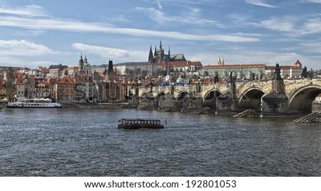 The Prague Castle and the Charles bridge - stock photo