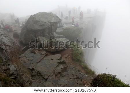 The Preikestolen rock taken in deep fog, Norway - stock photo